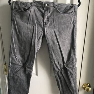 Grey denim jeans with silver rhinestones on pocket